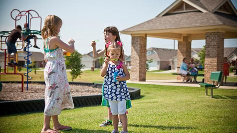 Children playing in a Featherstone Community park around our new homes in Moore OK from Ideal Homes