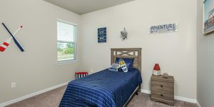 Kindred Homes Cape Coral Model Home Secondary Bedroom