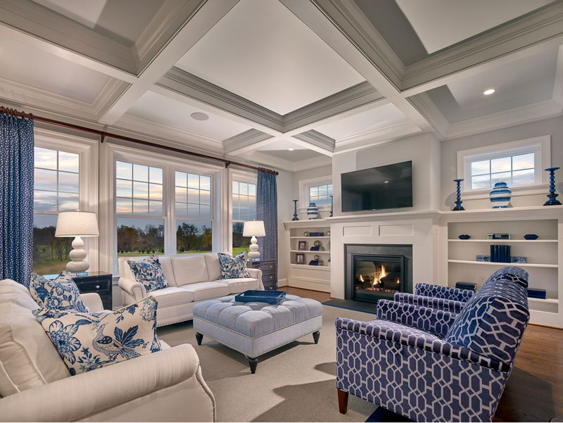 Family Room at Chapel Hill family room with blue and white decorating, seating, fireplace and windows with view to yard