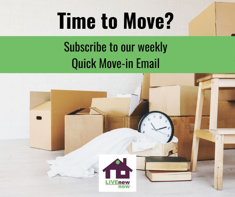 moving boxes, clock, blanket, stool