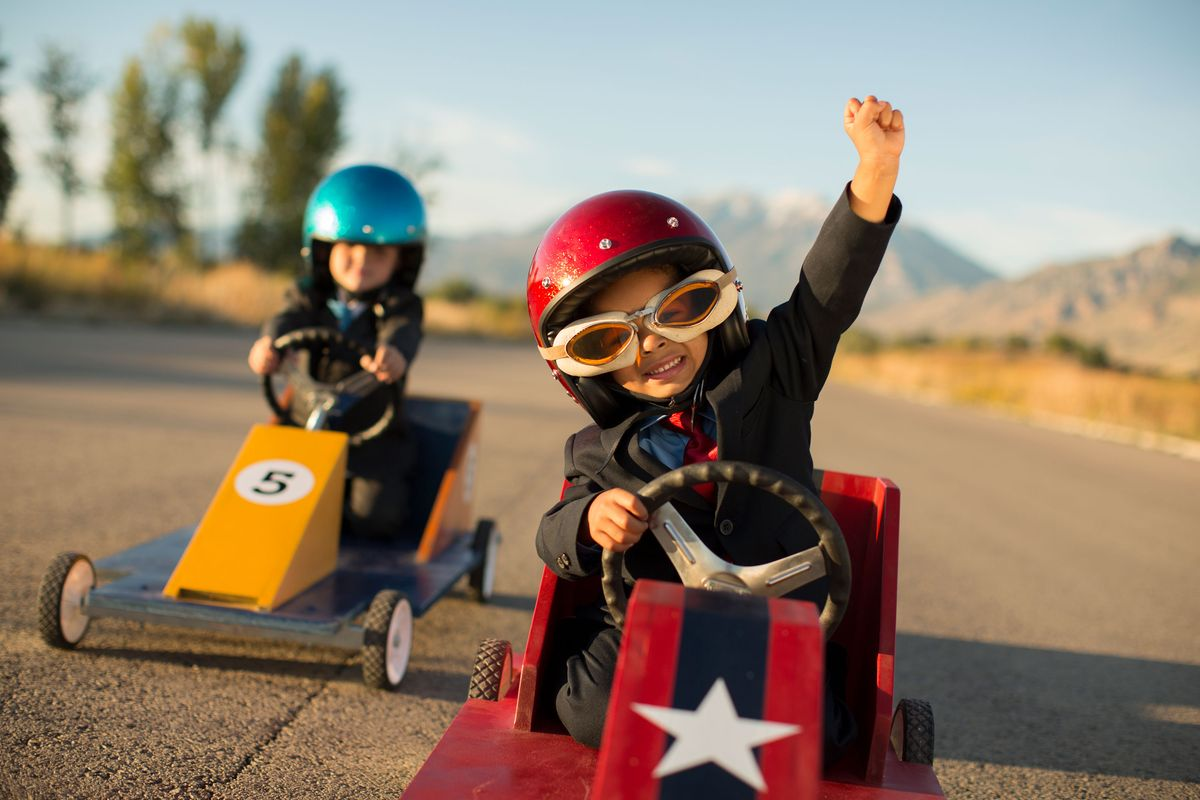 Kids driving go-karts in a Mungo new home community