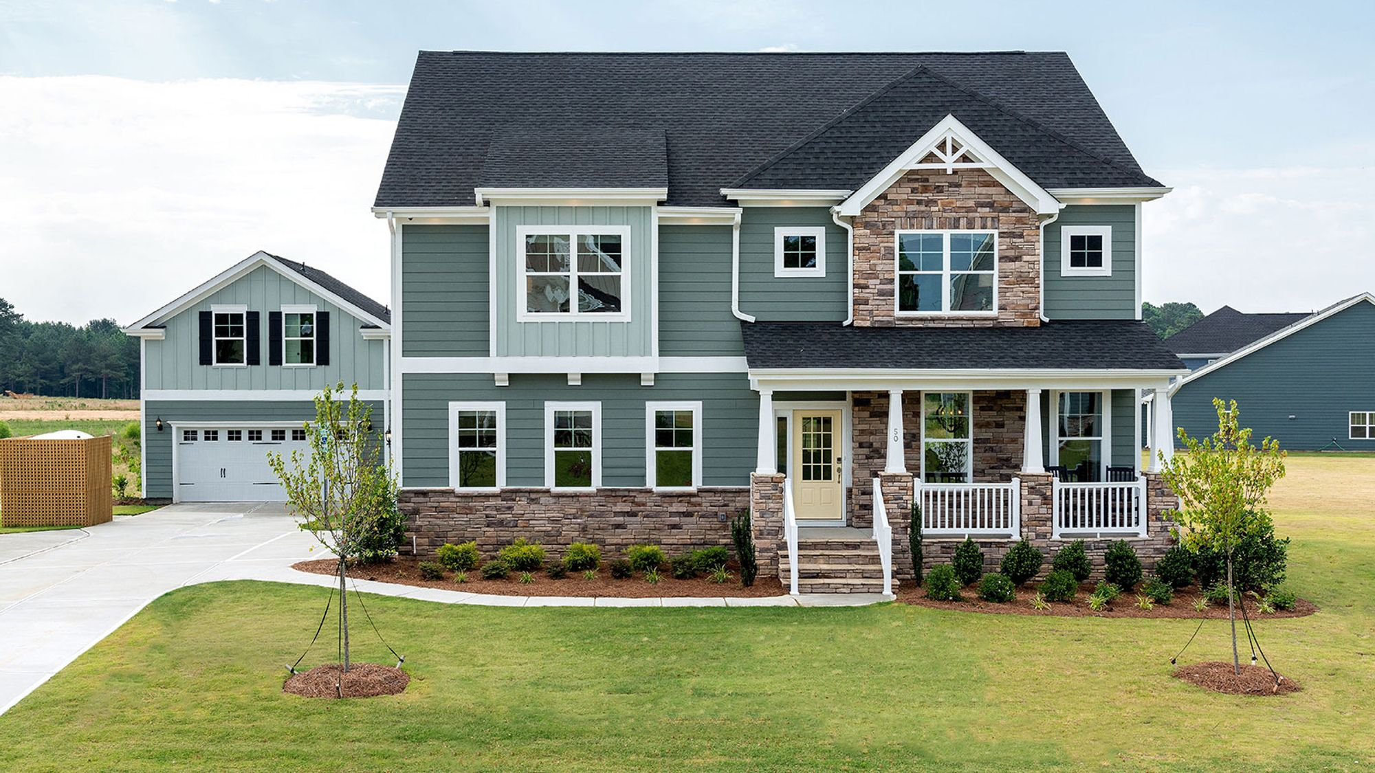 New home in Clayton NC with green exterior