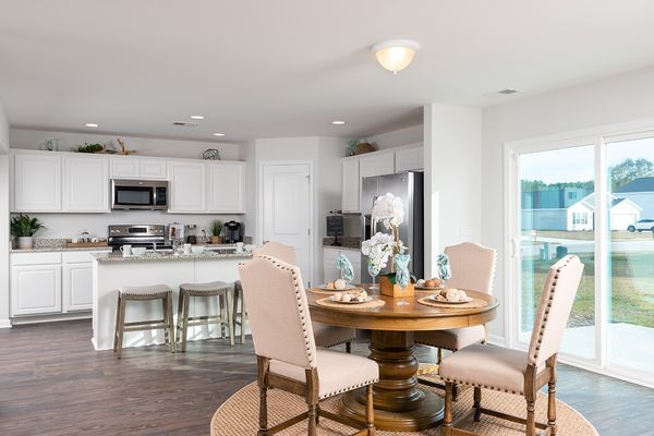 Kitchen and dining area in an Adens Place home