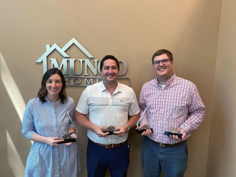 Mungo Homes employees holding Charleston Homebuilder's Association PRISM Awards