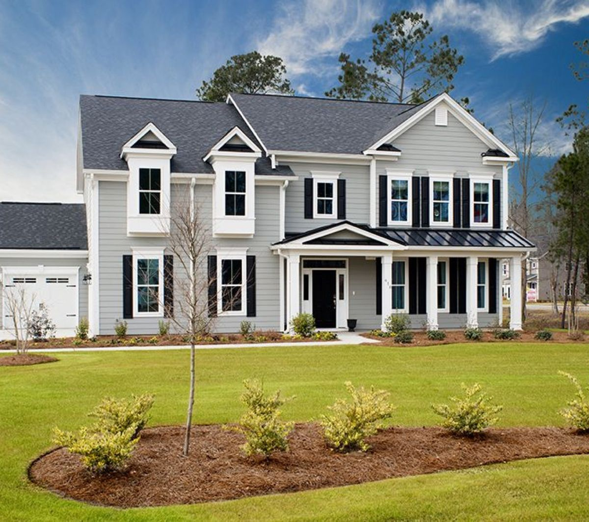 New construction two-story home with large lawn