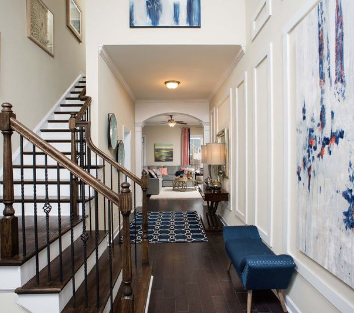 Entryway with staircase and view of living area