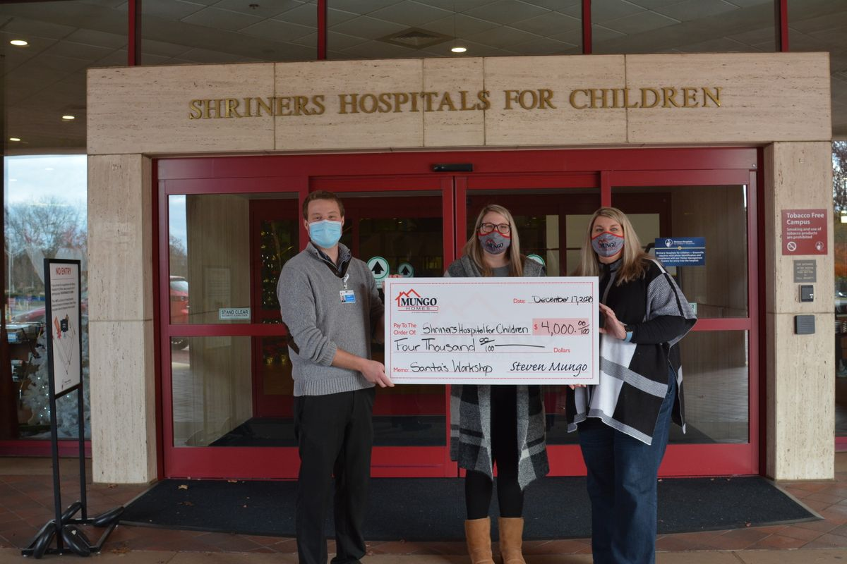 Mungo Homes delivering donation to community organization in Greenville, NC
