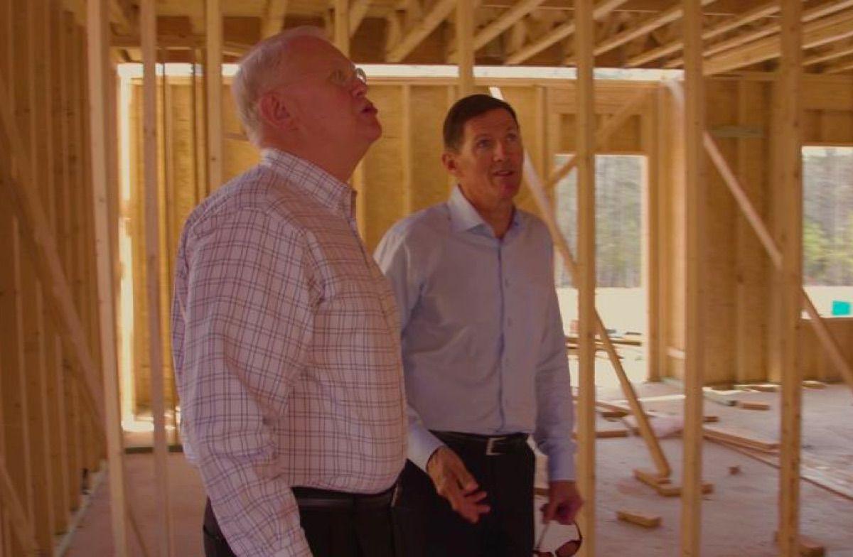 Mungo Homes founder touring a construction site