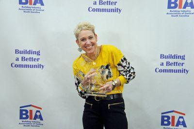 Kim O'Quinn receiving home builder awards for Mungo