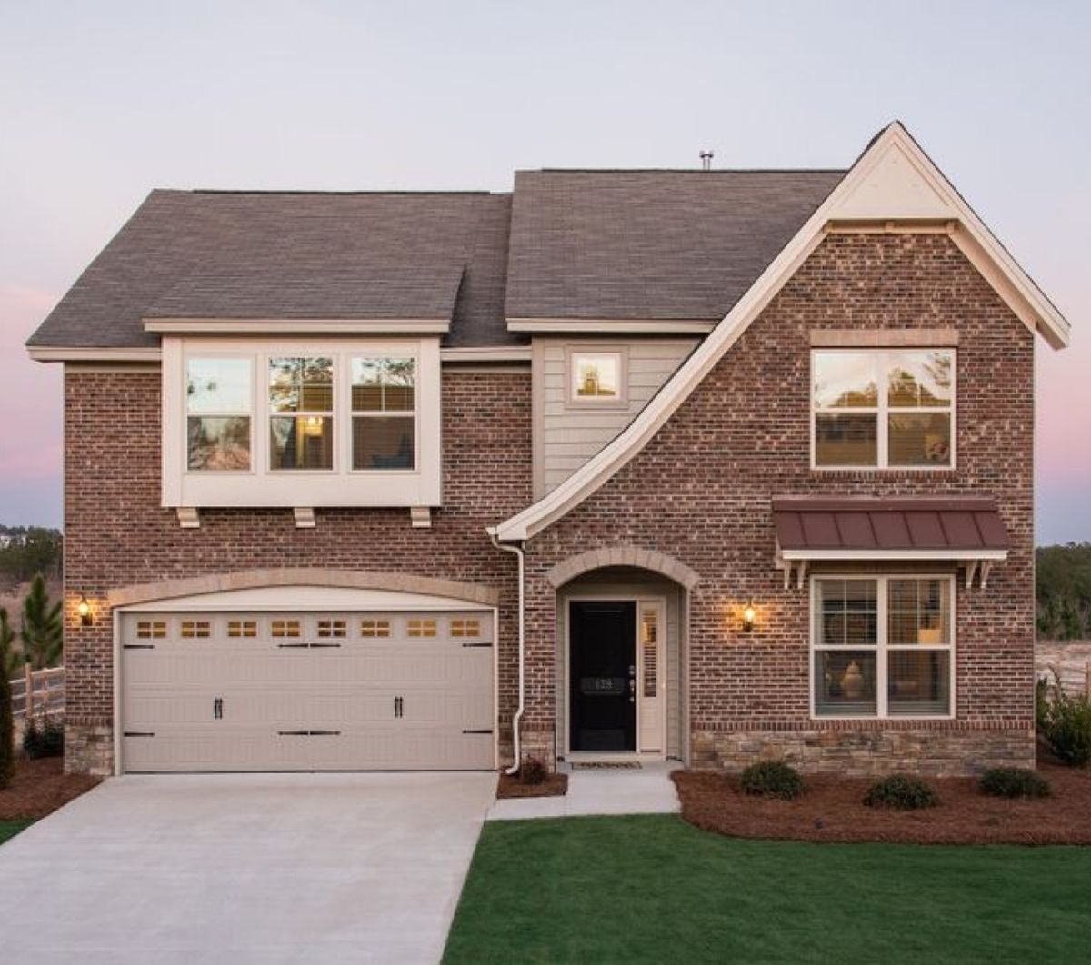 Brick two-story house by new home builders, Mungo Homes