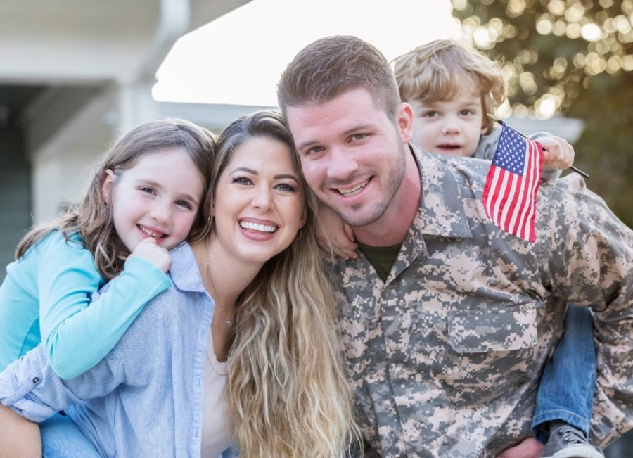 A soldier with wife, son, and daughter
