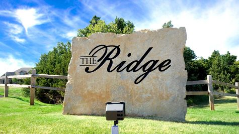 entrance to new home community, the ridge, in edmond, OK by nu homes OK