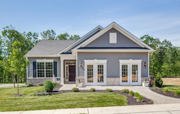 The exterior of the Zinnia model new home and sales office at Whitehall Gardens in Williamstown, NJ, a 55+ active adult community.