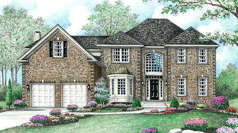 All brick front Stoneleigh Georgian new home in NJ illustrated with large arched window over front door, decorative bay window, hip roof line.