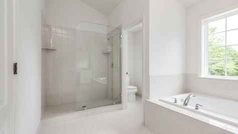 Baldwin master bath with walk-in shower with glass surround, soaking tub, large window, toilet in own room