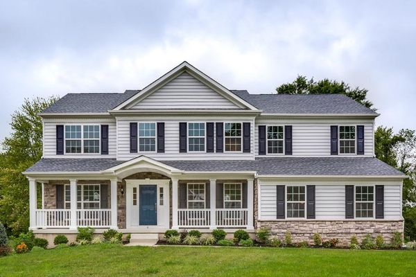 Exterior of Baldwin Federal model new home with optional porch, siding, shutters, colonial elements & central peak.