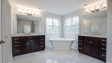 Brandywine large master bathroom with two separate vanities & sinks plus soaking tub