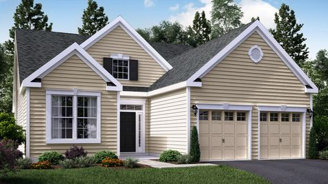One Story Marigold Cottage active adult new home in South Jersey with cream colored siding, colonial trim, transom & sidelights around door, 2 car garage.