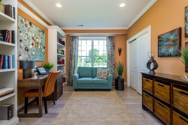 One story new home in South Jersey offering home office, with desk, chair, love seat, book shelves and storage