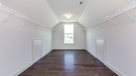 Huge walk-in closet in the Stoneleigh master bedroom and window at far end of closet.