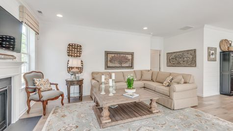 Different view of family room with sample furniture in Zinnia model new home, a one story ranch style.
