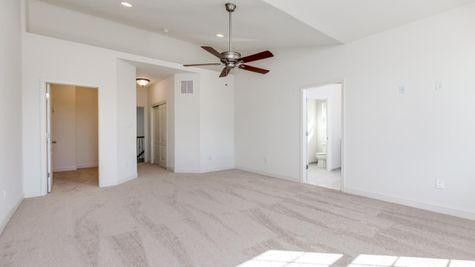 Bedroom with pale carpet in Avignon model new home