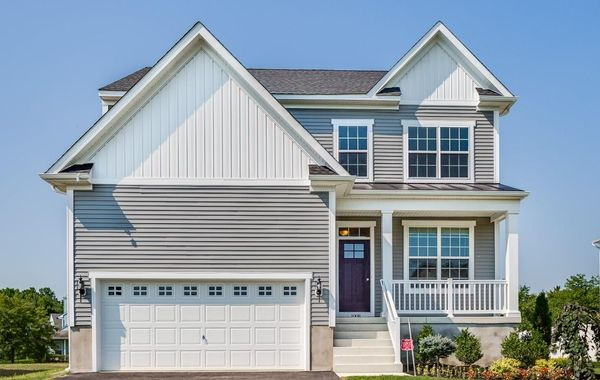 Exterior of the Laurelton Grand new home in south New Jersey with light gray siding and small porch on front.