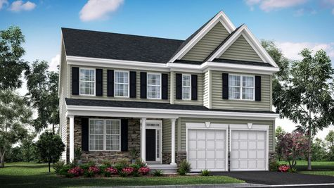 The Oakton Traditional model home in NJ illustrated with light green siding, stone accents, black shutters, front veranda, 2 car garage.
