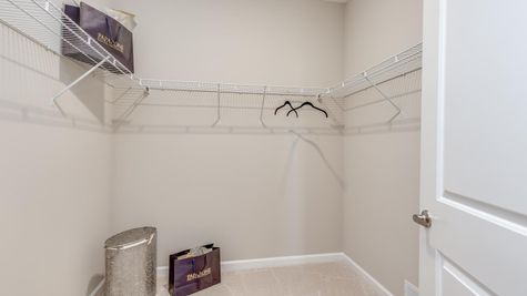 Primrose model new home for age 55+ active adults walk-in closet in master bedroom.