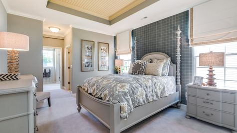 The Jasmine model new home, one story, in NJ master bedroom suite, decorated with sample furniture, carpet.