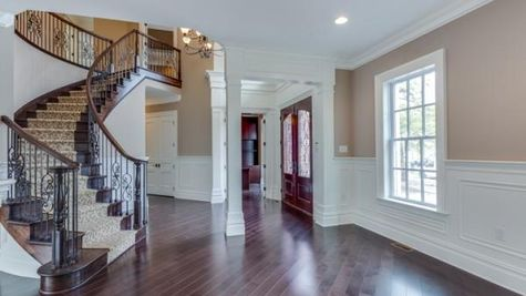 Stoneleigh Curved front stair case, decorative railings, front hall.