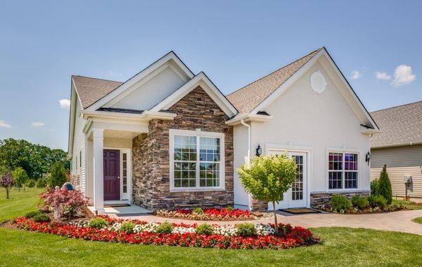 The exterior of the sales office at Whitehall Gardens 55+ active adult community in Williamstown NJ, a Jasmine Villa model.