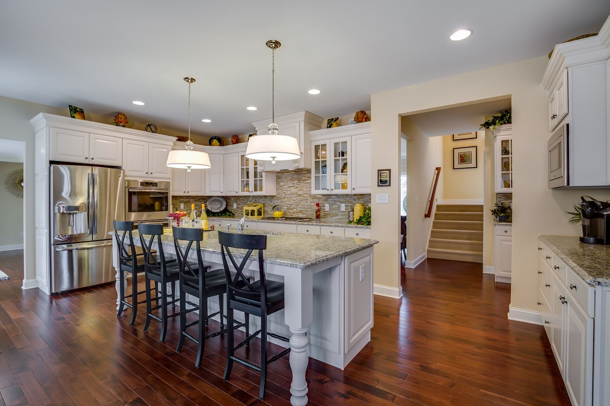 Spacious kitchen with large center island and stainless steel appliances inside the luxurious Brandywine model