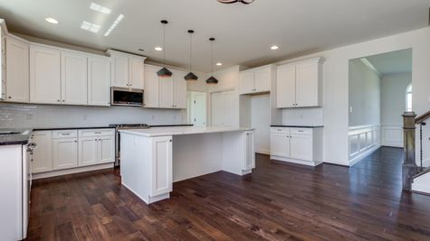 Baldwin kitchen with white cabinets and wood floors.