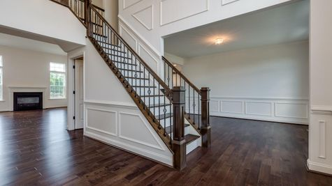 Baldwin model new home staircase with decorative handrails.