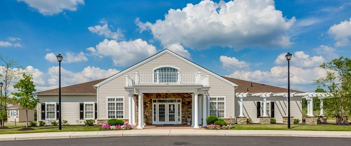 The clubhouse at The Village of Country Gardens is the focal point of this active adult lifestyle community in Mantua NJ