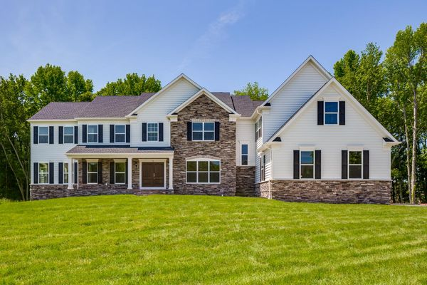 Exterior of Brandywine model new luxury home in NJ with siding, stone, shutters and small porch