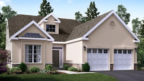 The Marigold Villa active adult home design, one story, illustrated with light tan stucco, decorative trim around front window, two car garage.