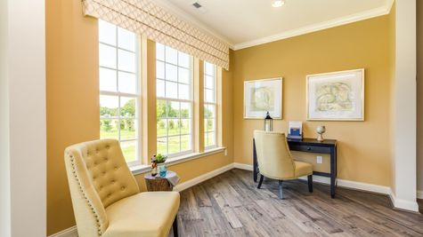 Hawthorn model home with home office or extra bedroom, large windows, sample furniture