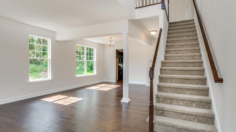 Front Foyer of the Ashton with stair case to second floor and view of the living room.
