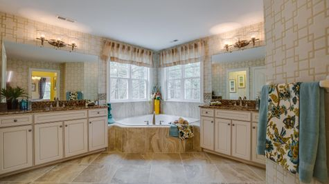 Very large master bathroom in Brandywine with two different vanities and sinks plus soaking tub