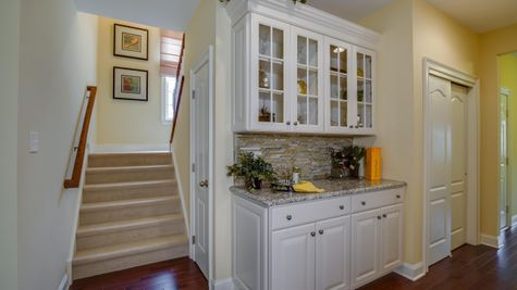 Back staircase next to kitchen in Brandywine model new home.
