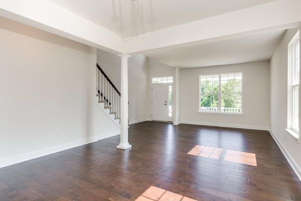 Living room of the Ashton model home in South Jersey, white, wood floor, no furniture.