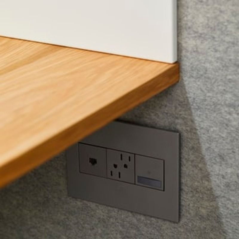 A grey outlet positioned underneath a counter