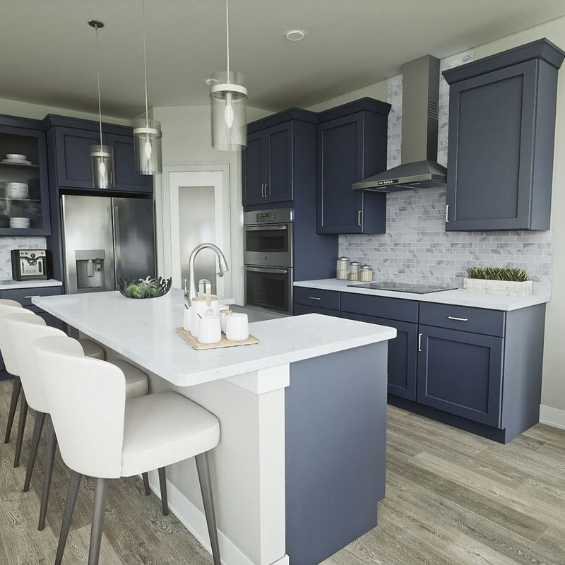 Modern kitchen with stainless steel appliances built by custom home builders Robertson Homes in Michigan