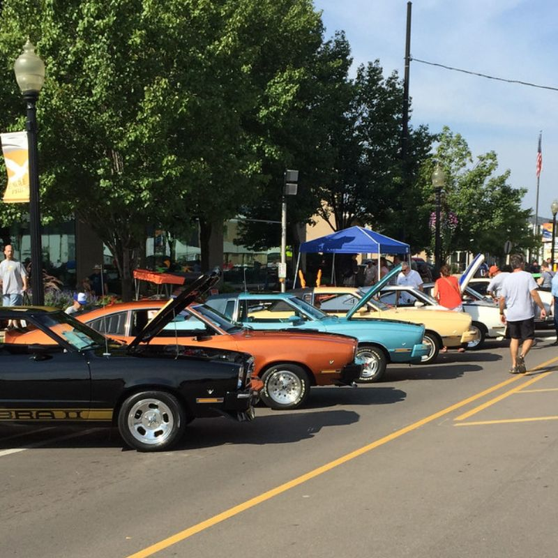 Several classic cars lined up for the Woodward Dream Cruise in Detroit, Michigan