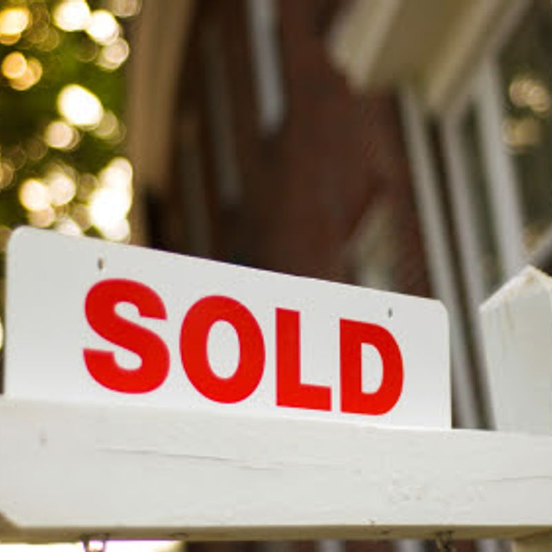 A sold sign posted outside of a home accompanying a blog post by Robertson Homes in Michigan