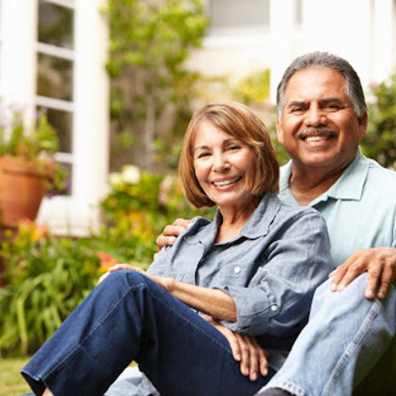 An older couple sitting outside representing the downsizing tips provided by Robertson Homes in Michigan