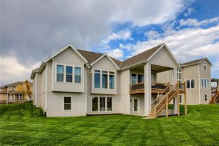 Rear Elevation with Walk out Lower Level. Pictures are of Model and May Feature Upgrades. Not Actual Home.