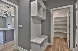 Mud Room with Boot Bench & Cubbies. Access to Walk In Pantry.